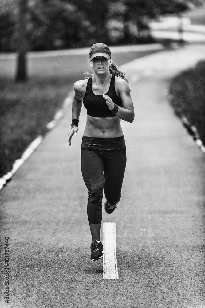 Obraz Tryptyk Woman jogging in black and