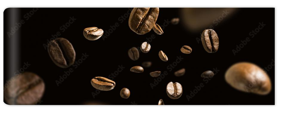 Fototapeta Coffee beans in flight on a