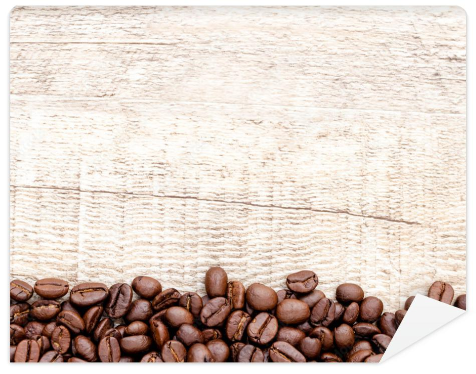 Fototapeta Coffee on wooden background.